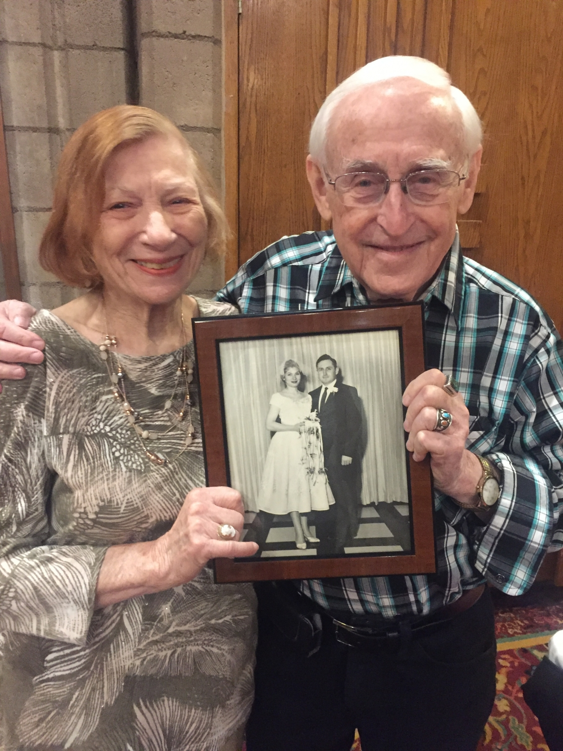 Dick and Judy Lovins holding their wedding photo