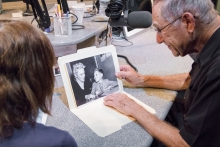 Michael Markson shows Judy Bartlestone a photo with his mom, taken when he was a young boy.